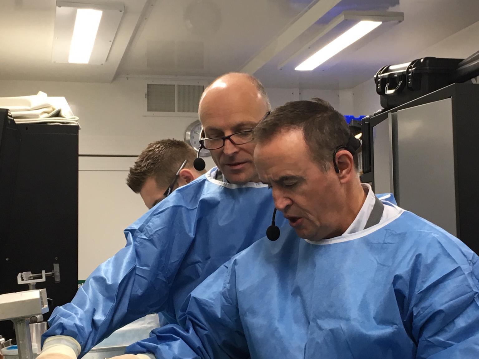 Surgeons in wet lab
