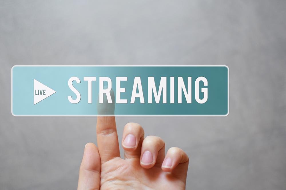 Live streaming - hand pressing transparent blue button
